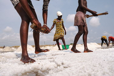 Women and girls labouring in a salt pan in the 'Yomo', the area traditionally held to be the spiritual heart of the salt-rich Songor Lagoon. It is traditionally taboo to win salt in this area of the l...