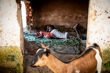 A family sleep in the remnants of a house after torrential rain caused the Mulongwe River to break its banks. The ensuing floods caused significant material damage with at least 3,500 homes destroyed...
