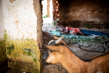 A child sleeps in the remnants of a house after torrential rain caused the Mulongwe River to break its banks. The ensuing floods caused significant material damage with at least 3,500 homes destroyed...