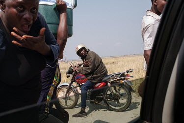 Daniel Atteh Tsirapah (57) astride his motorcycle outside the small village of Midie on the edge of the 'Yomo', the area traditionally held to be the spiritual heart of the salt-rich Songor Lagoon. Li...