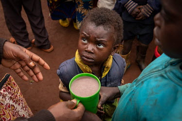 Childre recieve porridge, which is a free service that's being put on by Antionette, an accountancy graduate, who was inspired to start the clubs when she saw that children and elderly people were bei...