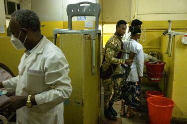 Staff and a soldier at the Gondar Hospital where they are treating wounded soldiers returning from the front line in Tigray.