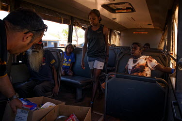 People on a council bus that serves the satellite communities on the edges of Wadeye town, helping residents to shop, attend school and access services found in the town. Due to tensions between triba...
