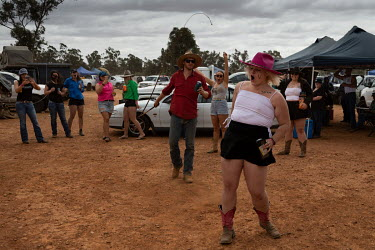 A man cracks a whip on the buttocks of an apparently willing female participant at the Ariah Park, Bachelor and Spinster ball, her first B&S ball.  Known to locals as simply B&S balls, the events ar...