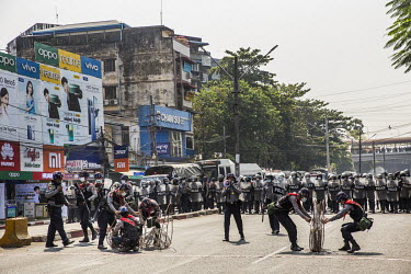 Riot police set up a blockade in response to protestors, including student activists and factory workers, marching in a show support for the NLD (National League for Democracy), Aung San Suu Kyi and d...