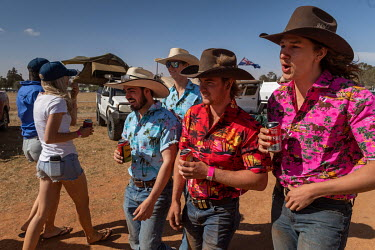 A group of men dressed in colourful shirts during the Ariah Park Bachelor and Spinster ball.  Known to locals as simply B&S balls, the events are held regularly in rural towns, run by local voluntee...
