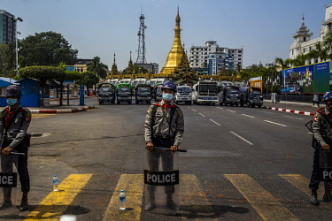 A line of riot police block the road in front of the Sule pagoda in the centre of Yangon.