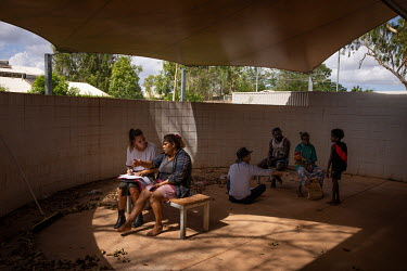 North Australian Aboriginal Justice Agency Lawyer (NAJA) Holly Fitzsimmons, speaks with Brenda Melpi (36) in the Wadeye police station and courthouse courtyard. Melpi was due to attend court on a viol...
