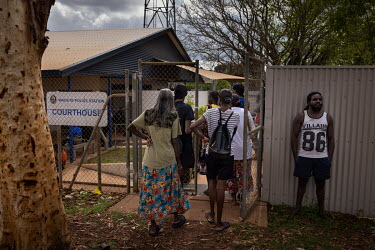 People walk through the security gate at the entrance of Wadeye police station and courthouse.   Northern Territory (NT) Local Circuit Courts, or 'bush courts', operate in 30 remote Aboriginal communi...