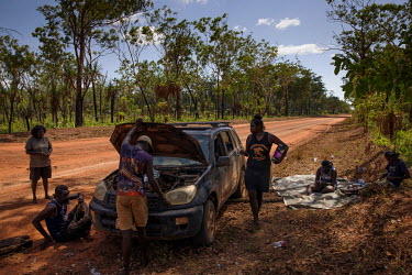 A car that has broken down on the outskirts of Wadeye Aboriginal community. During the wet season, for four or five months each year, the town can only be accessed by plane or by boat, in the drier mo...