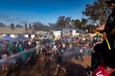 Partygoers are sprayed with water during the 'Wet T Shirt' competition at the Ariah Park Bachelor and Spinster ball. The town's fire truck sprays water on to the crowd and shortly after the women are...