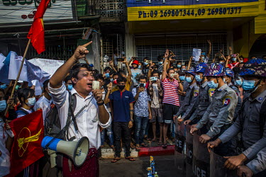 Protestors talk to police and try to persuade them to join the people as thousands gatherin a show support for the NLD (National League for Democracy), Aung San Suu Kyi and democracy and to protest th...