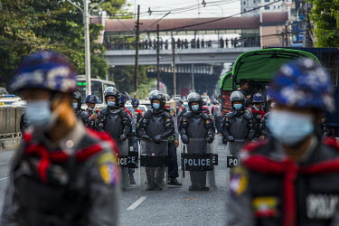 Riot police form a blockade in response to protestors, including student activists and factory workers, marching in a show support for the NLD (National League for Democracy), Aung San Suu Kyi and dem...