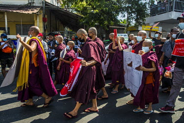 Buddhist monks participate as tens of thousands of people gather to protest against the military dictatorship and demand the release of Aung San Suu Kyi and other elected leaders.
