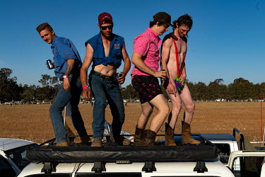 Partygoers dance on top of pick up trucks ('Utes') during the Ariah Park Bachelor and Spinster ball.  Known to locals as simply B&S balls, the events are held regularly in rural towns, run by local...