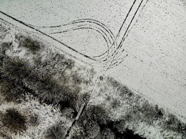 Vehicle tracks in the snow in a recreational area in the municipality of Stara Lysa which received a state subsidy from an EU Fund under the Operational Program Environment for the project 'Wetland' i...