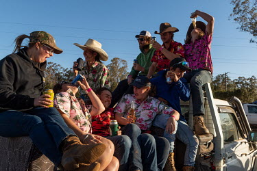Partygoers drinking in the back of a pick up truck during the Ariah Park Bachelor and Spinster ball.  Known to locals as simply B&S balls, the events are held regularly in rural towns, run by local...
