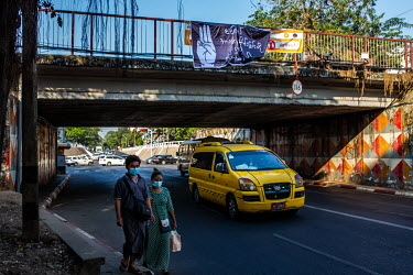 A banner hung from a road bridge by activists displays an image of the pro-democracy three fingers hand gesture and the slogan 'we don�t want military dictatorship'.