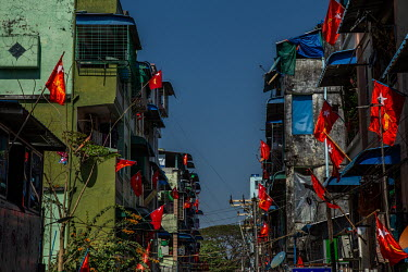 NLD (National League for Democracy) flags displayed from shops and residential buildings in a show of opposition to the military coup.