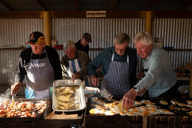 Eggsand bacon are cooked on a griddle by volunteers from the Ariah Park community who cook breakfast for the partygoers on the morning after the main ball at the Ariah Park Bachelor and Spinster ball....