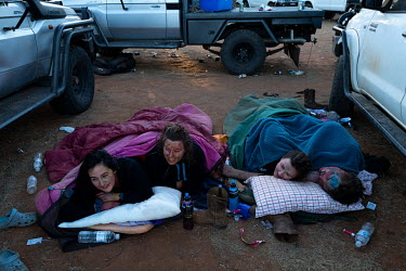 A group of friends wake in the carpark on the morning after the main party at the Ariah Park Bachelor and Spinster ball.  Known to locals as simply B&S balls, the events are held regularly in rural...