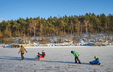 People playing on the frozen Bolevak (The Great Bolevec Pond), despite the ban on gatherings due to coronavirus restrictions.