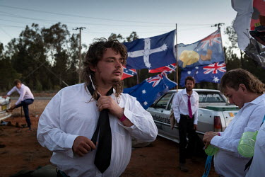 A man adjusts his tie as he gets dressed prior to the start of the Ariah Park Bachelor and Spinster ball.   Known to locals as simply B&S balls, the events are held regularly in rural towns, run by...