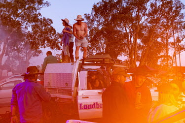 Partygoers dance on top of a truck at the start of the Ariah Park Bachelor and Spinster ball.  Known to locals as simply B&S balls, the events are held regularly in rural towns, run by local volunte...