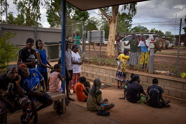 Clients (defendants and witnesses) and supporting family members try and find shade, while waiting in the courtyard of the Wadeye police station and courthouse.   Northern Territory (NT) Local Circuit...