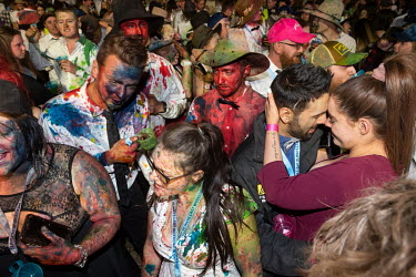 Partygoers covered in food dyes at the Ariah Park Bachelor and Spinster ball. Although food colouring is technically banned at the ball (security guards search patrons as they enter) It is still popul...