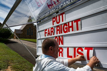 "Pastor Rod Bower changes the message on the church's billboard. One side reads: 'PUT THE FAR RIGHT ON THE TERROR LIST', the other says ""KEEP GOSFORD NUCLEAR FREE'.  Millions of people have viewed onli..."