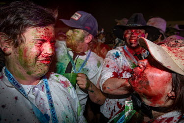A woman spits a mouthful of red food dye into a friend's face at the Ariah Park Bachelor and Spinster ball. Although food colouring is technically banned at the ball (security guards search patrons as...