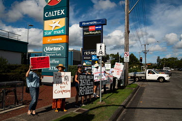 Members of the Anglican Parish of Gosford, joined by social justice supporters, protest the government's treatment of asylum seekers on a busy intersection in Gosford, near the office of Lucy Wicks MP...