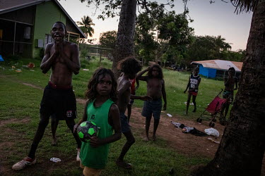 Children play outside their homes. Wadeye residents spend a lot of time outside their homes, cooking and playing as temperatures inside can become very hot and access to air-conditioning is limited.