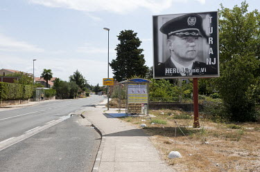 A roadside poster of Ante Gotovina, a former Lieutenant General in the Croatian Army who was sentenced to 24 years imprisonment for war crimes during Yugoslav war. For nationalist Croatians, he is sti...