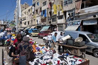 Street vendors selling secondhand clothes in the Sabra Palestinian refugee camp in West Beirut.