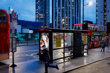 A bus stop in Elephant and Castle, during the 2021 COVID-19 lockdown, where a digital display carries a poster that is part of a campaign trying to promote compliance with coronavirus restrictions.