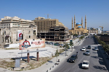 From left to right: A destroyed Catholic church, a ruined cinema complex and the new Al-Amin Mosque on the partly reconstructed Martyrs Square on the former demarcation line in the Lebanese capital. D...