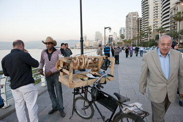 A vendor selling bread on the Corniche, the pedestrian boulevard on the Mediterranean Sea front.