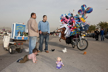 Vendors selling coffee and novelty balloons on the Corniche, the pedestrian boulevard on the Mediterranean Sea front.