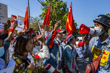 People protest in front of the Chinese embassy where they gathered in support for democracy, Aung San Suu Kyi and the National League for Democracy (NLD), and to protest the 1 February 2021 military c...