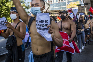 A group of bare-chested athletes demonstrating in support of democracy, Aung San Suu Kyi and the National League for Democracy (NLD) and to protest the 1 February 2021 military coup.