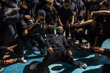 A group of young hip hop dancers perform a routine protesting the military dictatorship and to show support for the Civil Disobedience Movements.