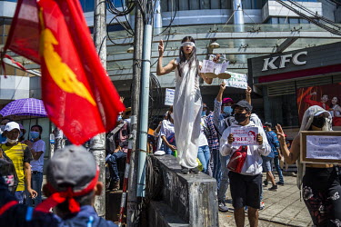 A woman dressed as Lady Justice as people demonstrate in support of democracy, Aung San Suu Kyi and the National League for Democracy (NLD) and to protest the 1 February 2021 military coup.