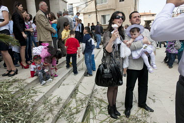 Maronite Christians gather on the steps of the Saint Saba Cathedral on Palm Sunday during Easter.