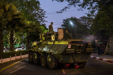 Myanmar army soldiers try to fix an armoured military vehicle that broke down while being driven through the city centre.