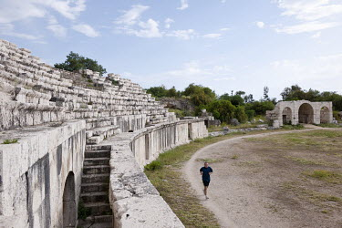A jogger runs around Roman-era archaeological ruins on the outskirts of Tyre.