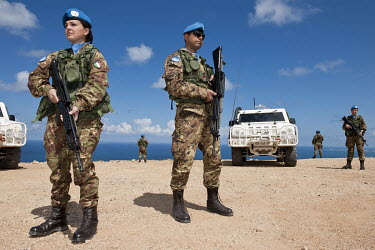 Italian UNIFIL soldiers on patrol near the Israeli Lebanese border.