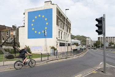 A Brexit mural by Banksy that was covered by the building's owners with white paint in 2019.