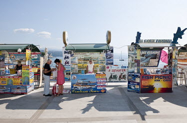 Tourist ticket booths selling excursions on the Adriatic Sea.
